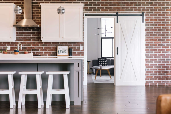 brick kitchen with a white sliding door