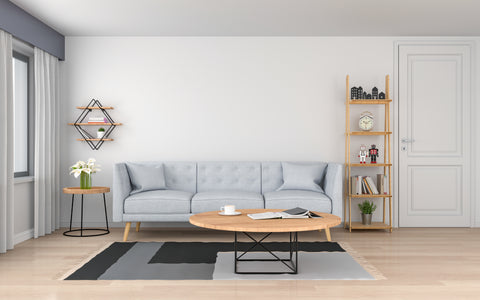 Living room with blue couch and round coffee table