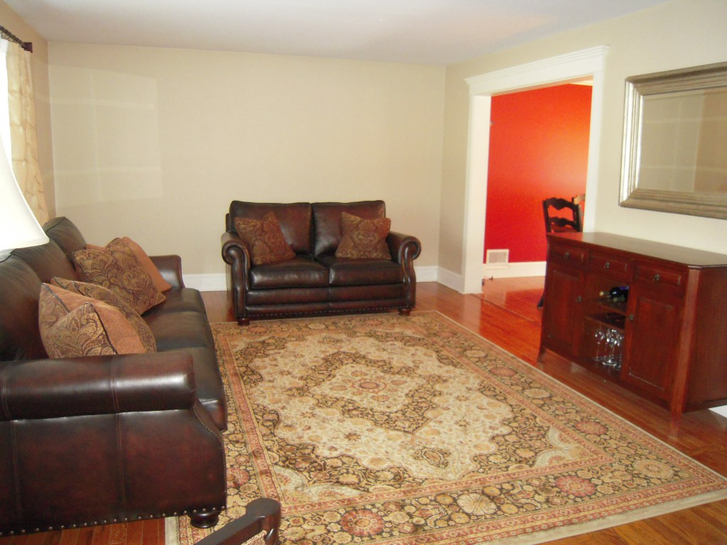 living room with brown furniture and no focal point