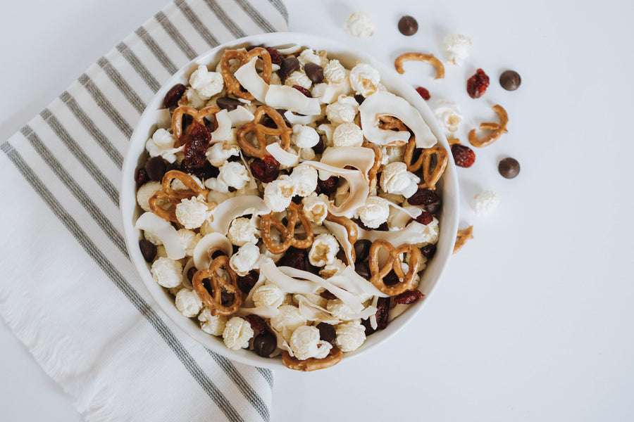 The BEST Coconut Cranberry Crunch Popcorn Recipe
