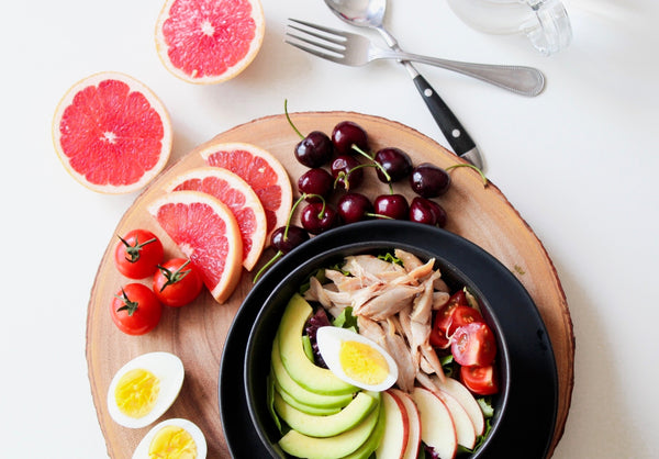 healthy gluten free meal featuring fruits and vegetables and grilled chicken
