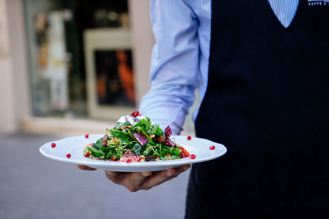waiter carrying salad