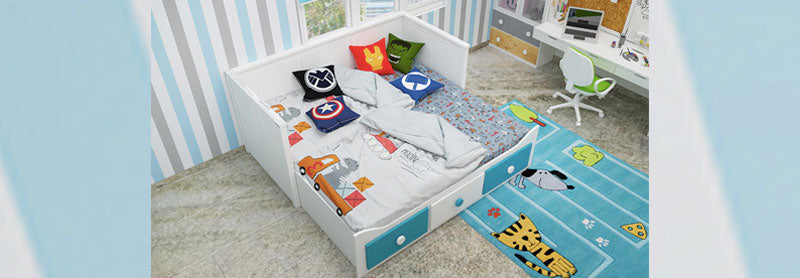 White and blue trundle bed with super hero furnishing