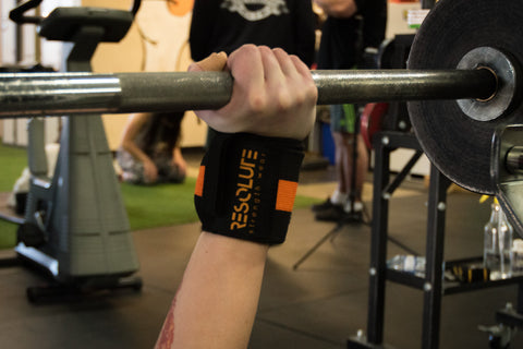 "18"" Wrist Wraps Black/Orange - Resolute Strength Wear"