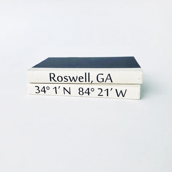 Roswell Coordinates Book Stack