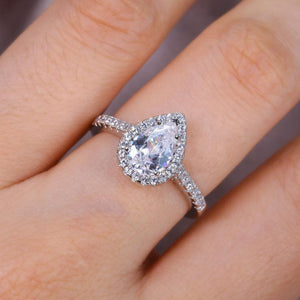 Pear Halo Travel Engagement Ring