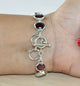 Oval Garnet Bracelet in Sterling Silver