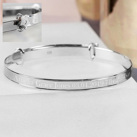 Personalised baby bangle in sterling silver with star detail supplied in a presentation box