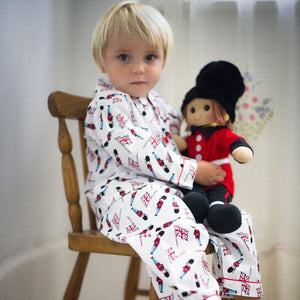 perosnalised rag doll in guard design with personalised pyjamas for boys