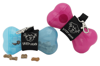 Tatty head dog treat dispenser and training aid in blue and pink