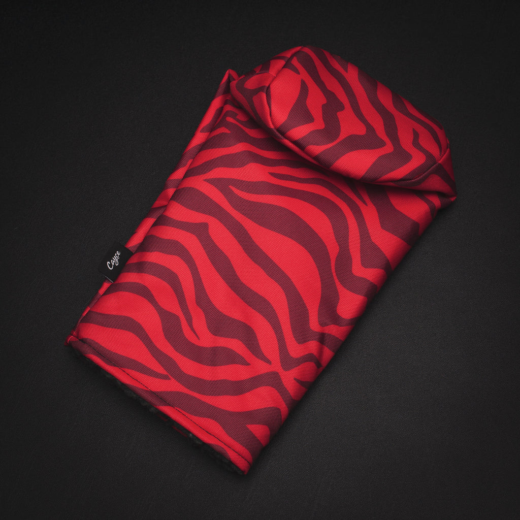 The G.O.A.T. Tiger Striped Headcover featuring RED tiger stripes