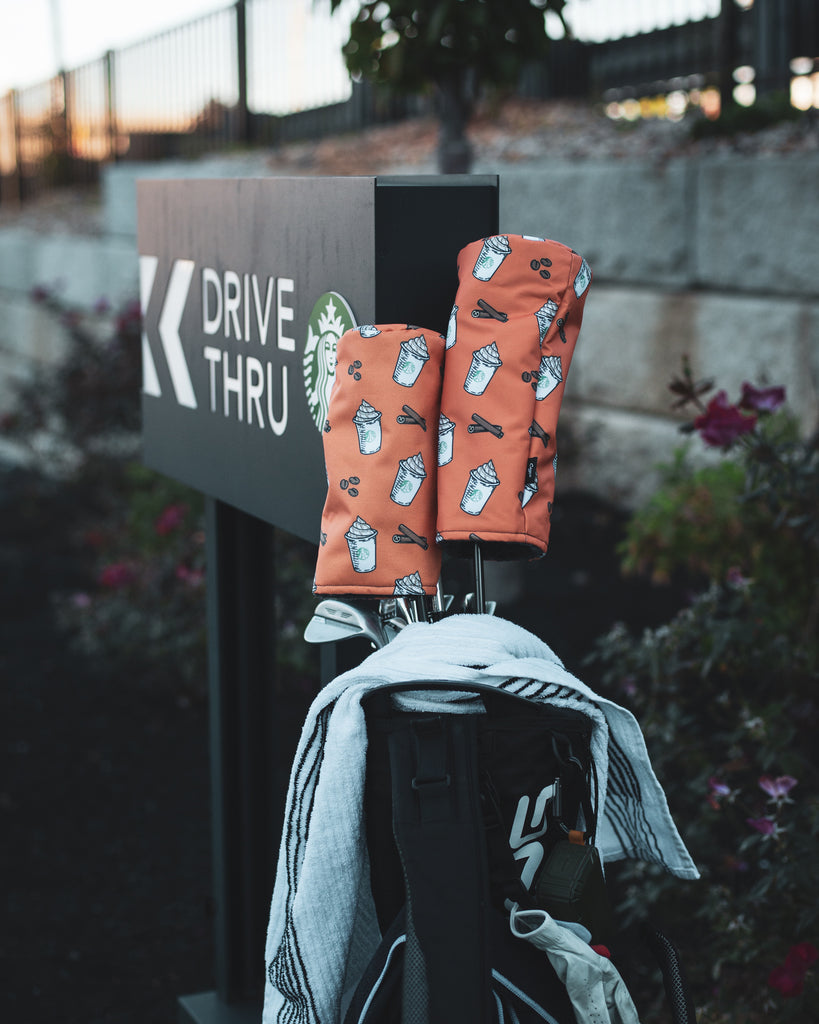 Pumpkin Spice Latte Headcovers on a golf bag laying against a drive thru sign (4777515614287)