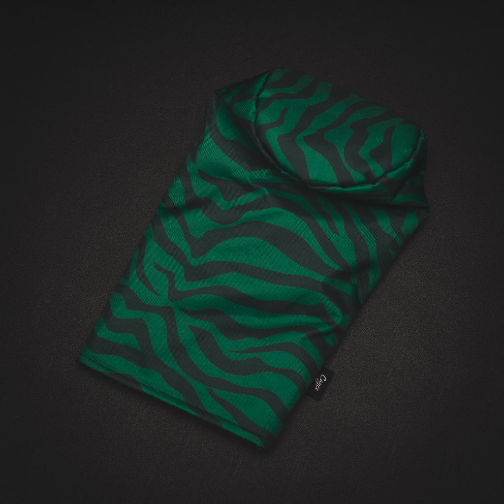 GOAT Driver headcover featuring green tiger stripes on a black background