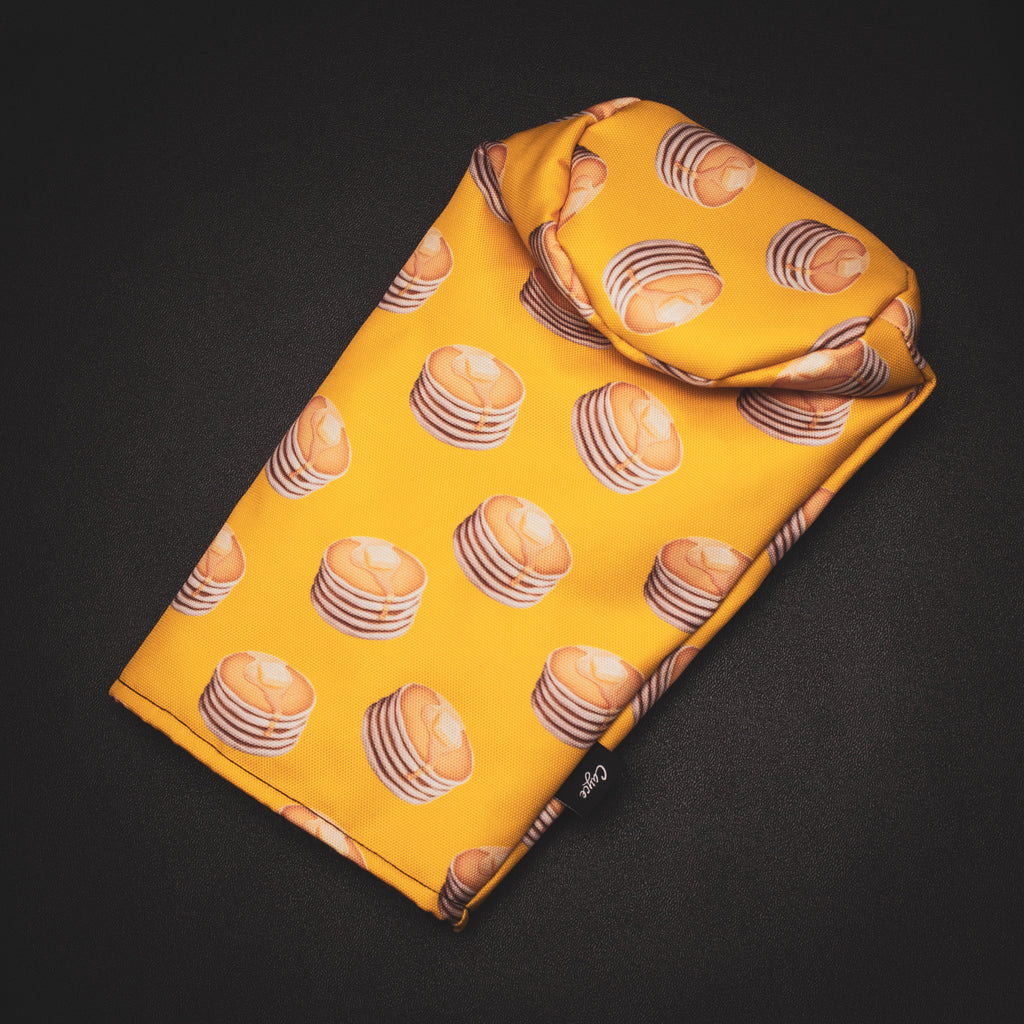 yellow golf headcover with stacks of pancakes on it