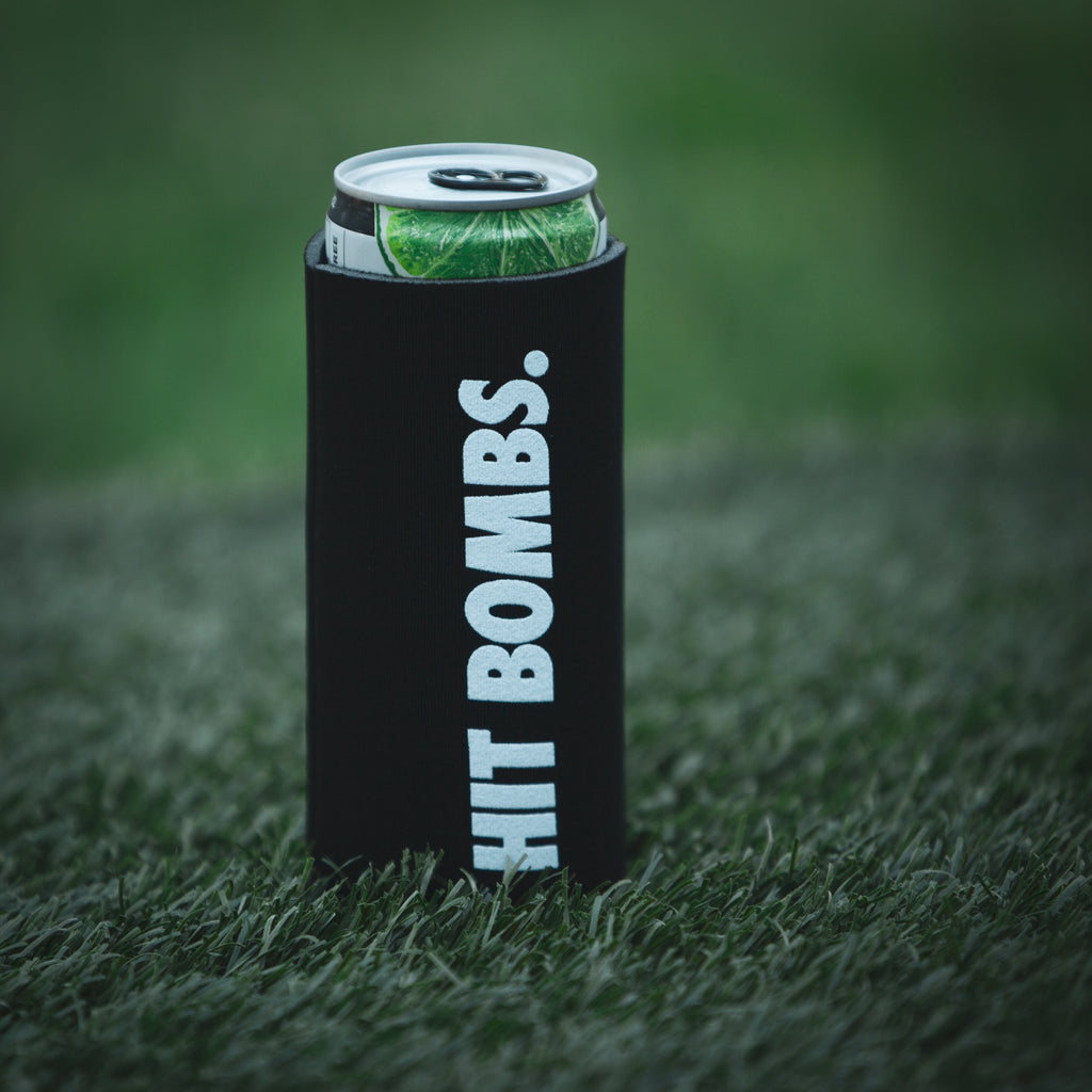 Hit Bombs Slim Coozie on a Truly can sitting on the tee box (4688195387471)
