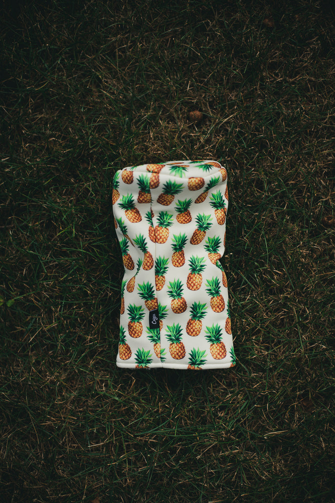 pineapple golf headcover laying in the green grass