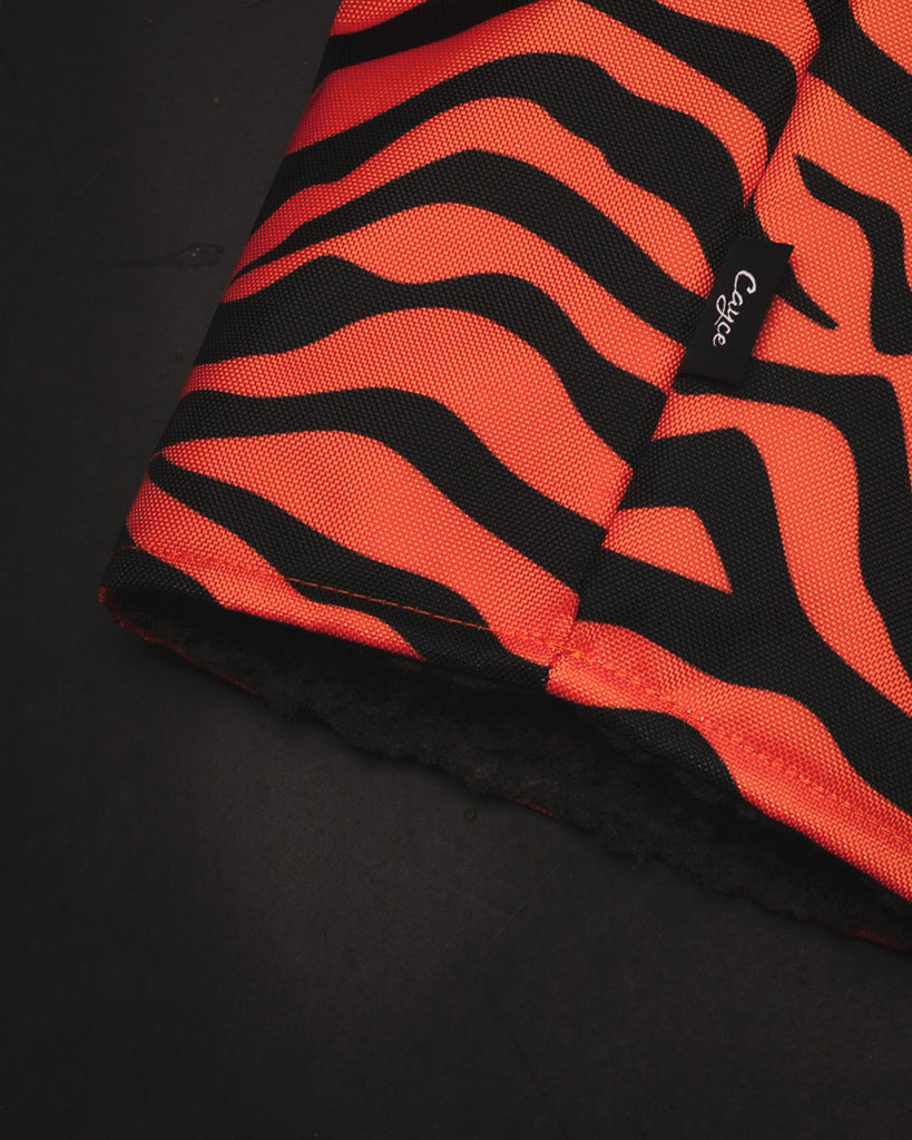 Close up view of the G.O.A.T. DURA+ golf headcover from Cayce Golf featuring a brilliant Tiger Stripe Design and plush charcoal lining