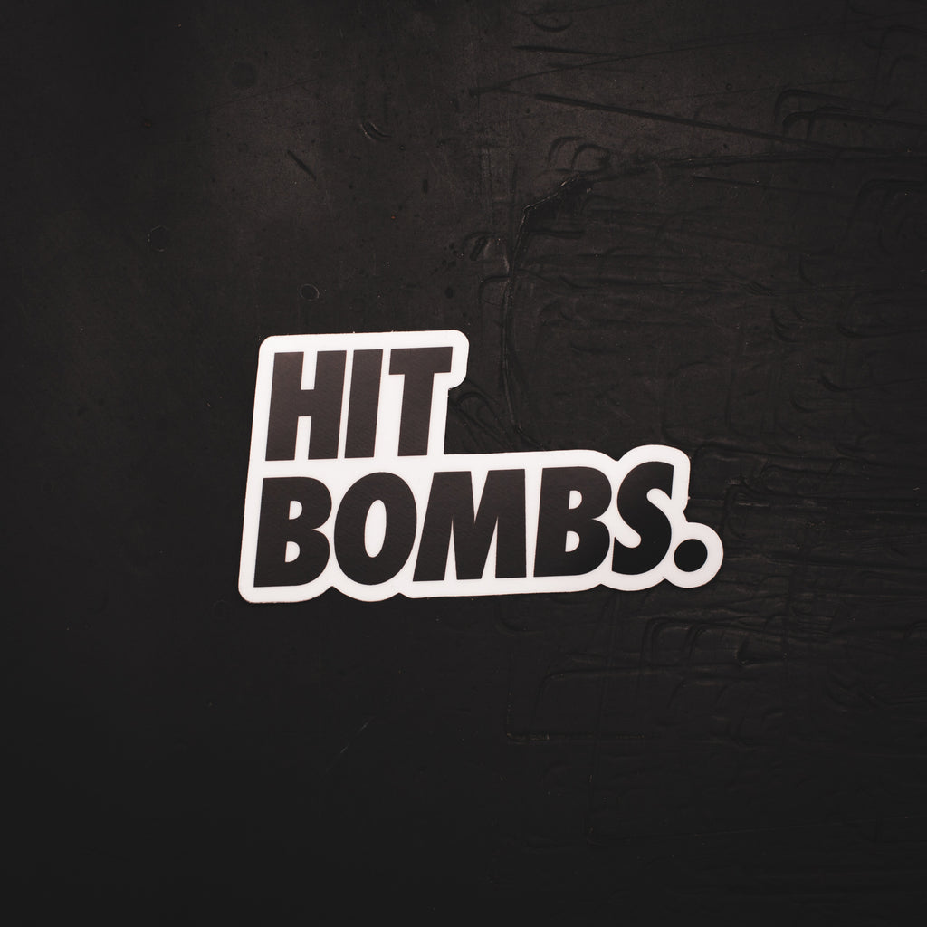 Hit Bombs Sticker on a desk.
