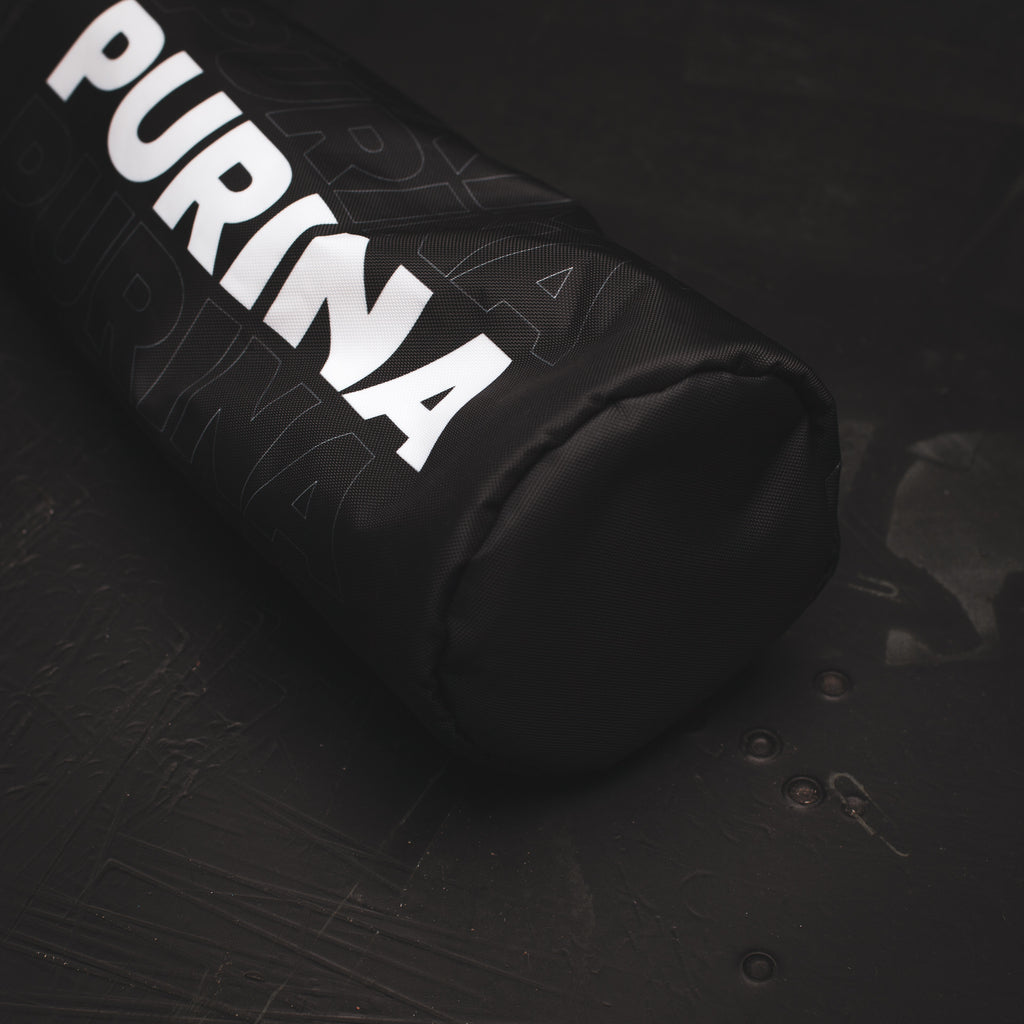 Close up view of the black PURINA driver headcover from Cayce