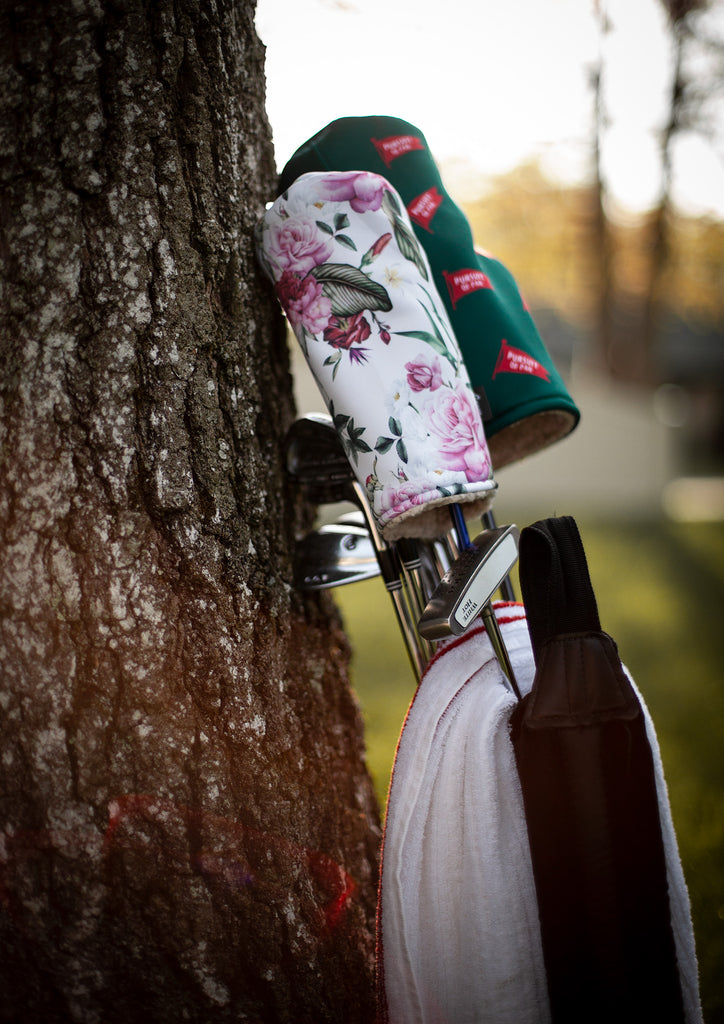 Floral Golf Head Cover Leaning Against a Tree