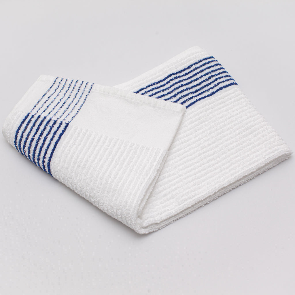blue striped caddy towel folded on a white background