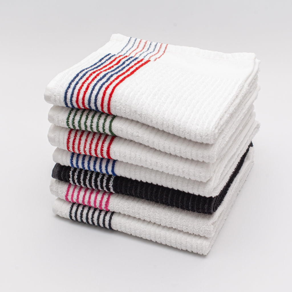 a stack of golf caddy towels with stripes. Red and navy stripes, green stripes, red stripes, blue stripes, black with white stripes, pink stripes, black stripes from Cayce Golf