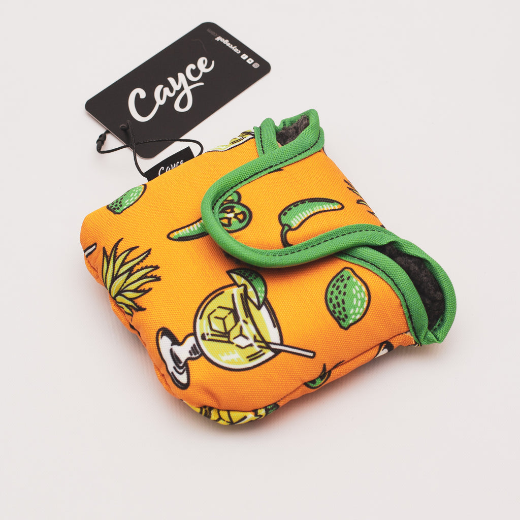 Margarita mallet putter cover featuring dancing margaritas, limes, agave, and jalapeño pappers on an orange background