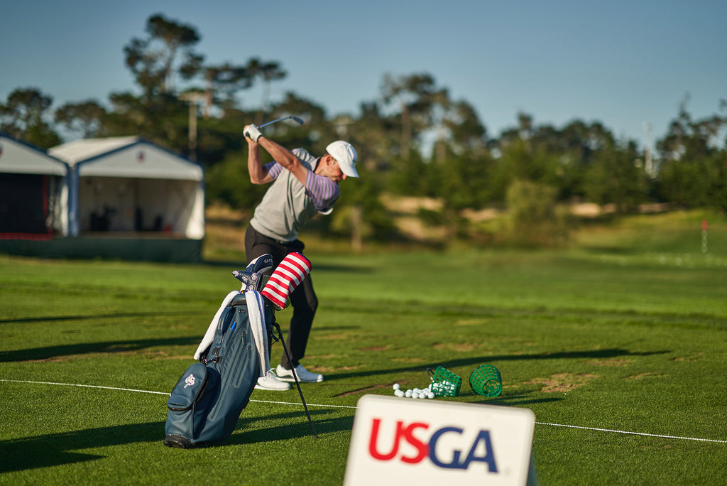 Mid-Am champion Matt Parziale warming up at the 2019 U.S. Open with his USA golf head covers