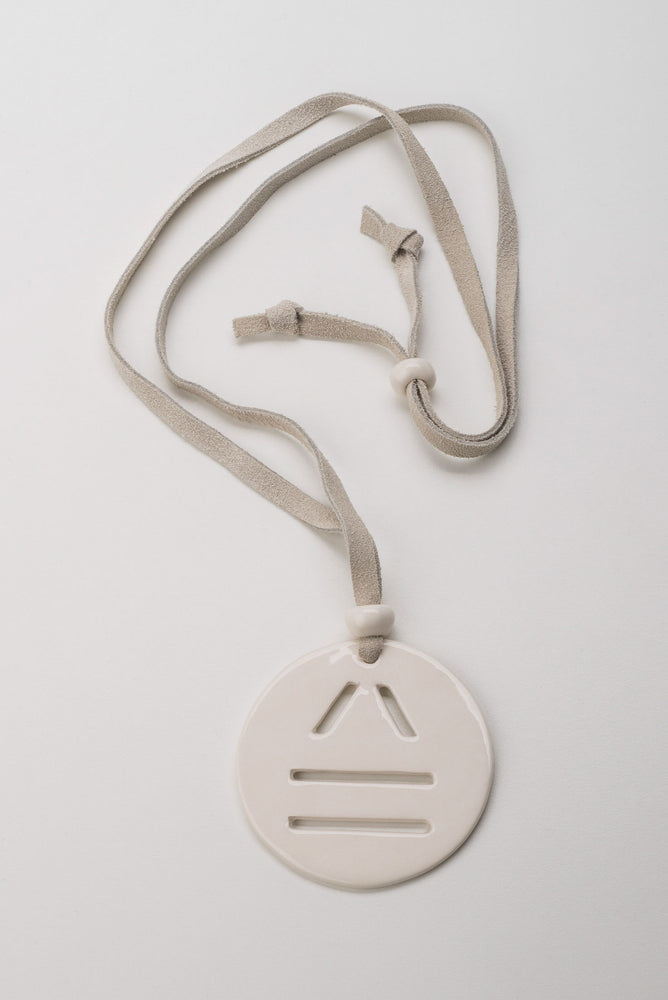 Load image into Gallery viewer, Carved Logo Circular Pendant