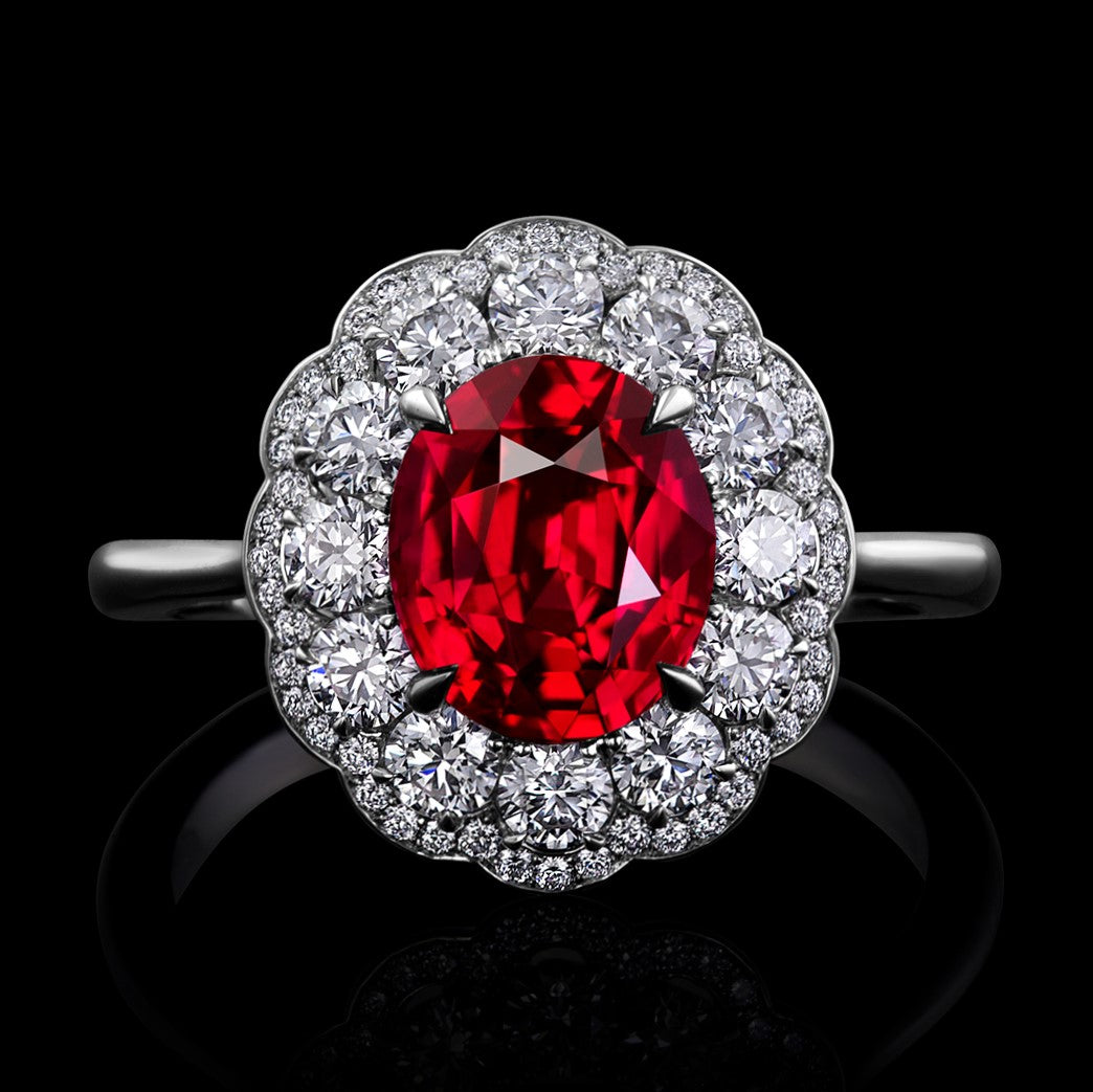Ruby Surrounded by Diamonds and Set in a Hand Fabricated Platinum ring.