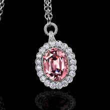 Load image into Gallery viewer, Pink Garnet Pendant Surrounded by  Platinum and Ideal Cut Diamonds.