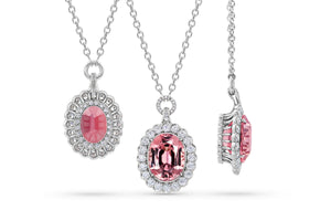 Pink Garnet Pendant Surrounded by  Platinum and Ideal Cut Diamonds.