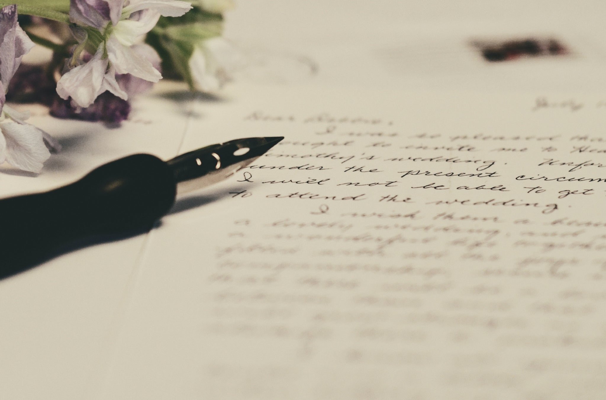 An elegant pen has been used to write a love letter - one of the most heartfelt and timeless gestures you can make | Talsam