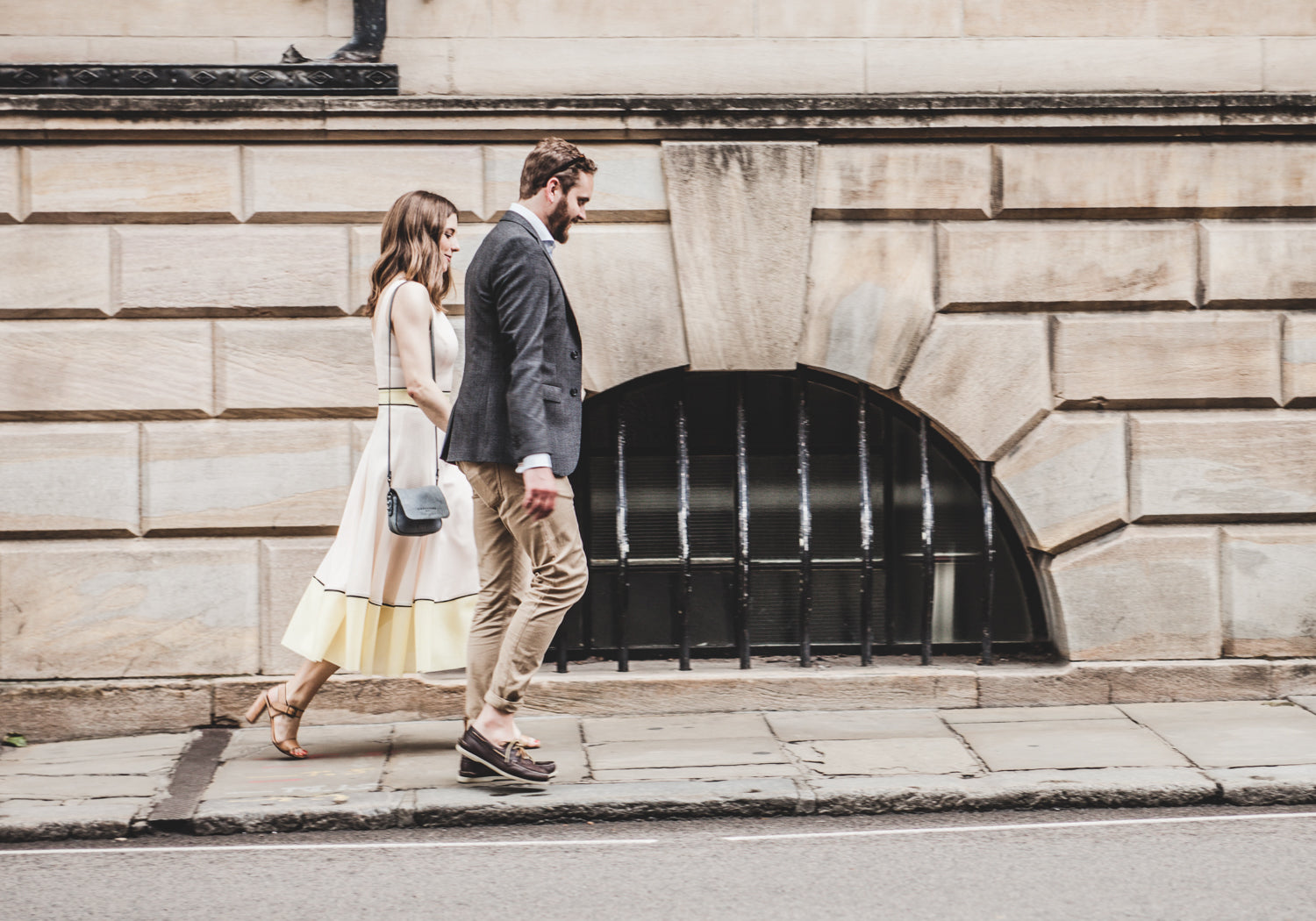 Couple walking on the sidewalk