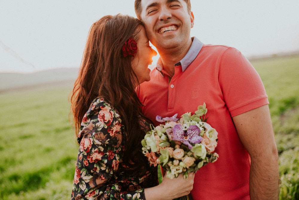 Surprise Flowers: a happy couple shares a lovely moment, surrounded by flowers | Talsam, Smart Jewelry