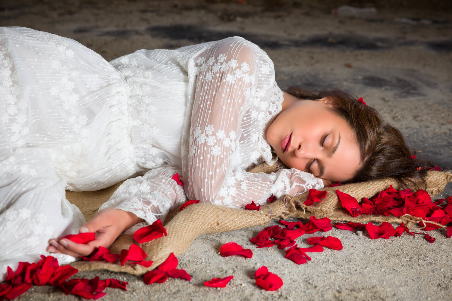Girl laying on floor with roses