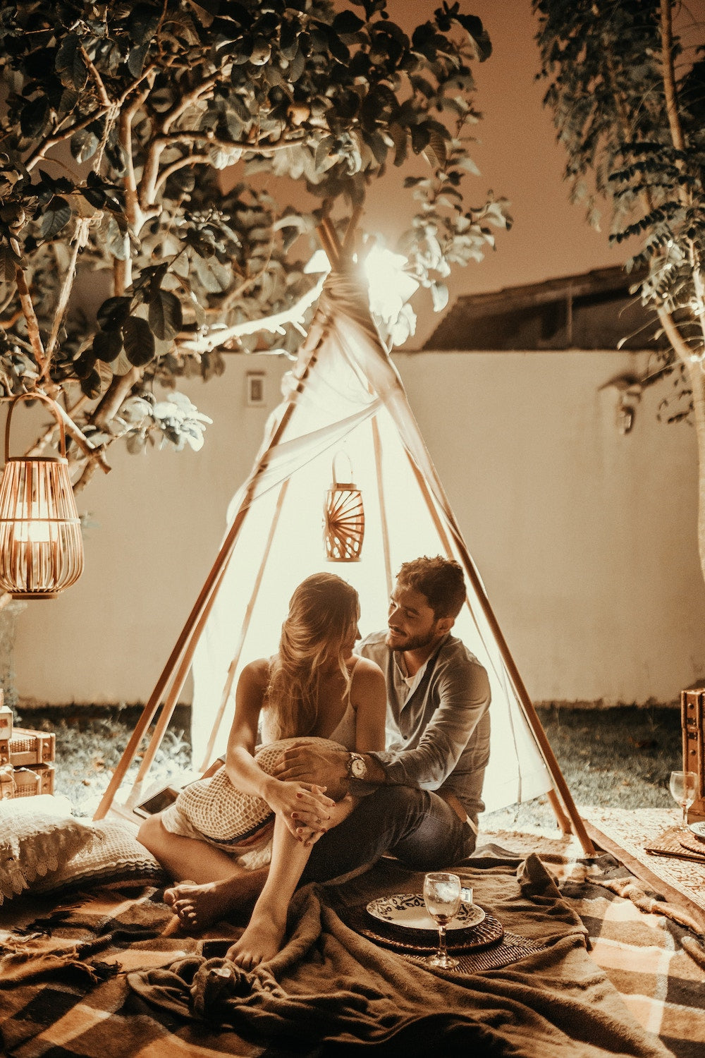 A couple shares an intimate moment under the lights | Talsam, Smart Jewelry