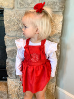 red pinafore