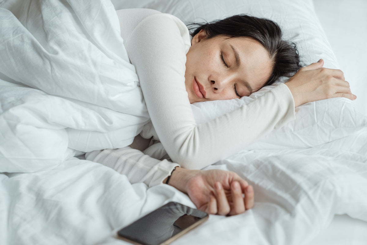 Women tired and in bed