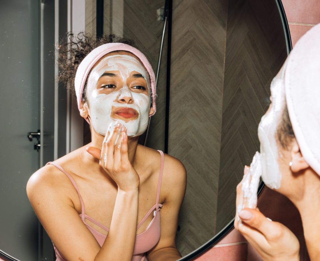 Image of women giving herself a facial