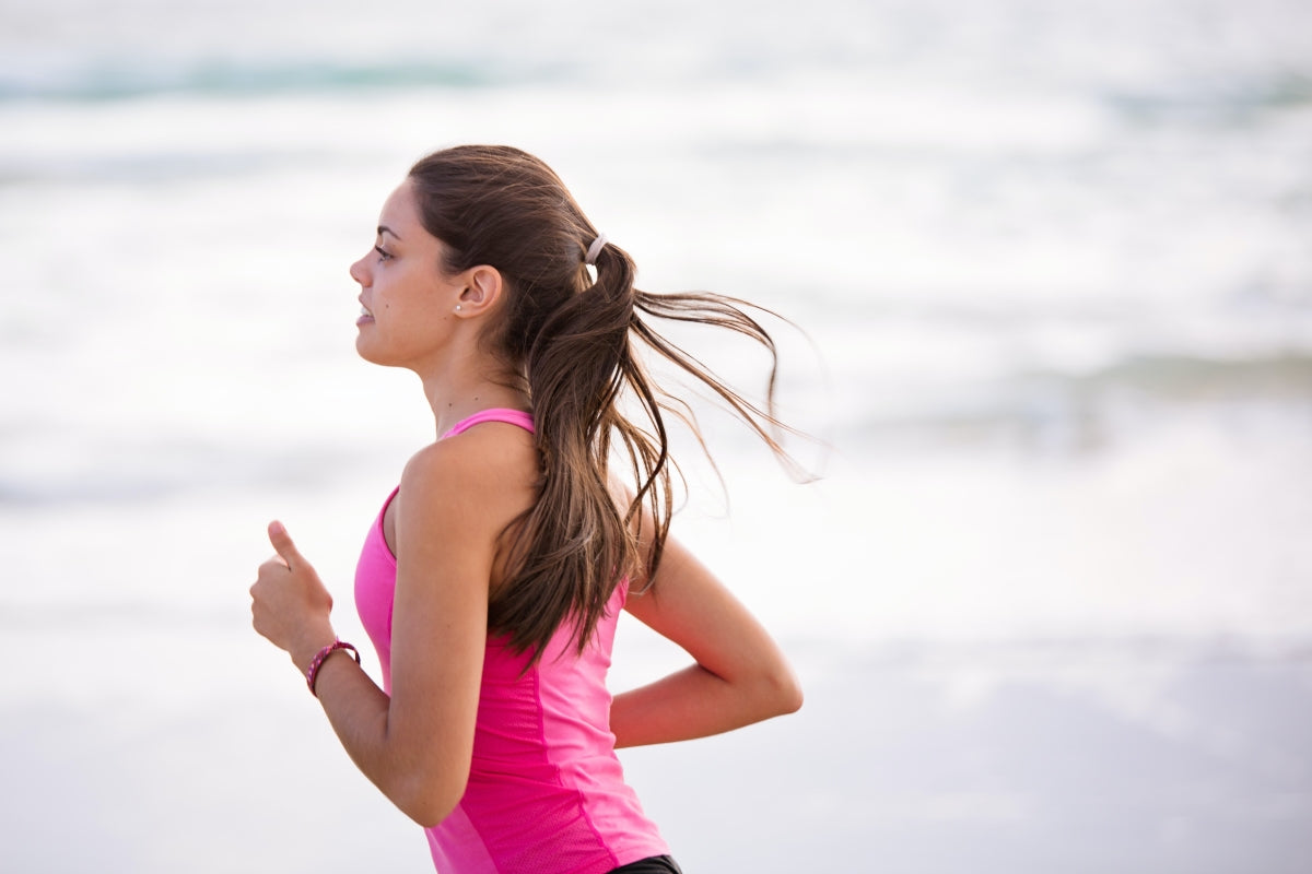A women running by the sea