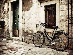 Bicycle in the Old Village Canvas Art