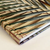 Corner cream and gold palm leaf tropical print luxury silk tencel covered notebook by leila Vibert-Stokes