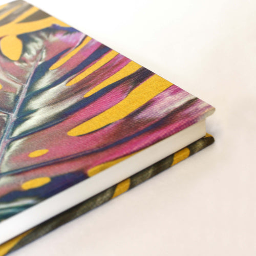 Corner yellow and pink monstera cheese plant print luxury silk tencel covered notebook by Leila Vibert-Stokes