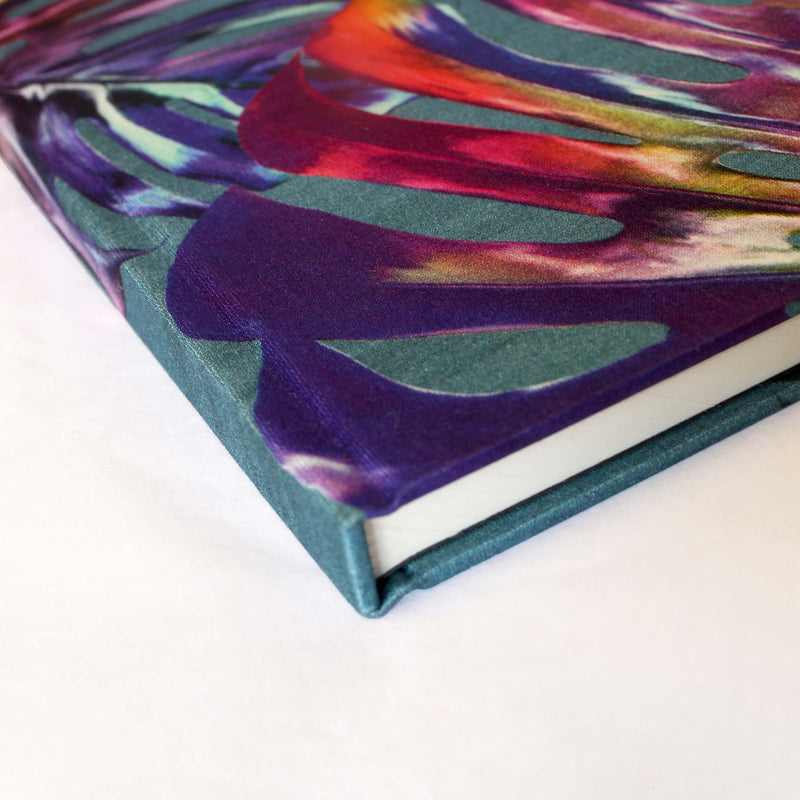 Corner blue turquoise and pink monstera cheese plant print luxury silk tencel covered notebook by Leila Vibert-Stokes