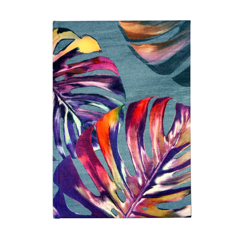 Front blue turquoise and pink monstera cheese plant print luxury silk tencel covered notebook by Leila Vibert-Stokes