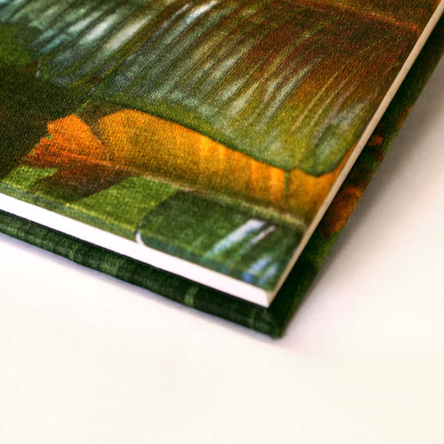 Corner emerald banana leaf print luxury silk tencel covered notebook by leila Vibert-Stokes