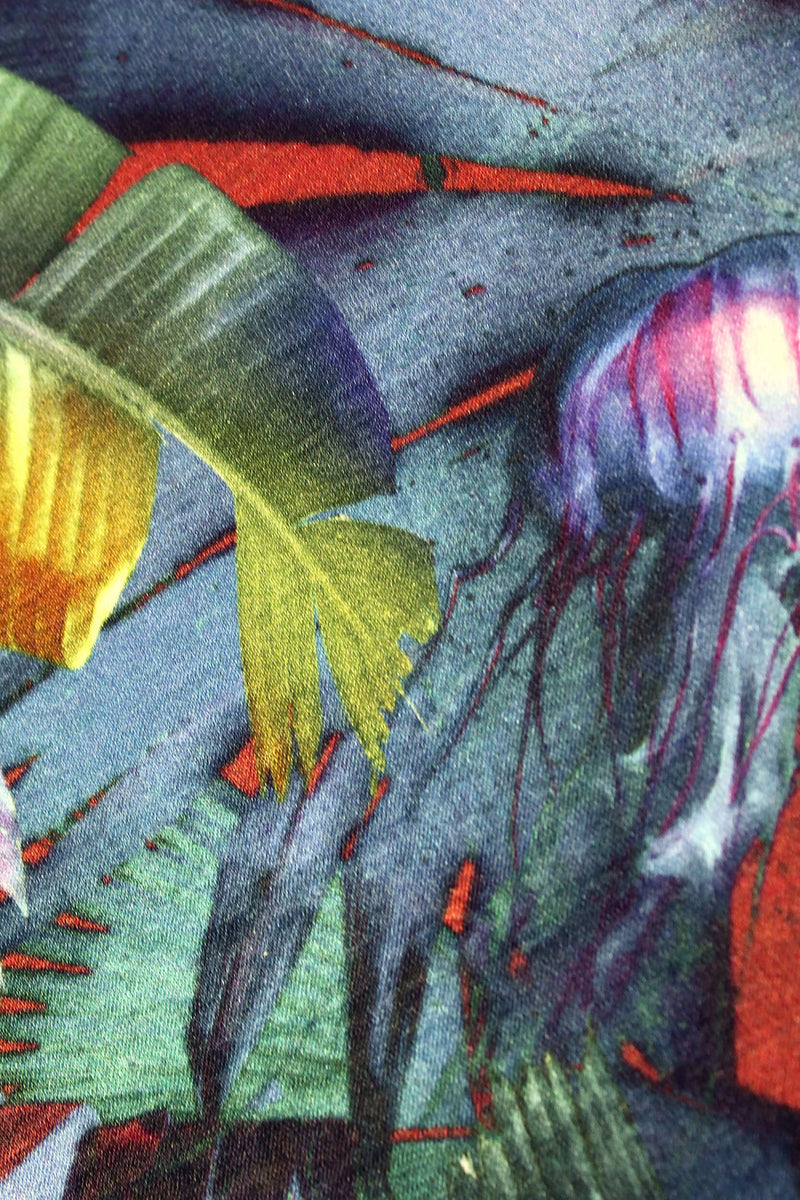 Close up blue red jelly fish palm leaf tropical print luxury silk notebook by Leila Vibert-Stokes