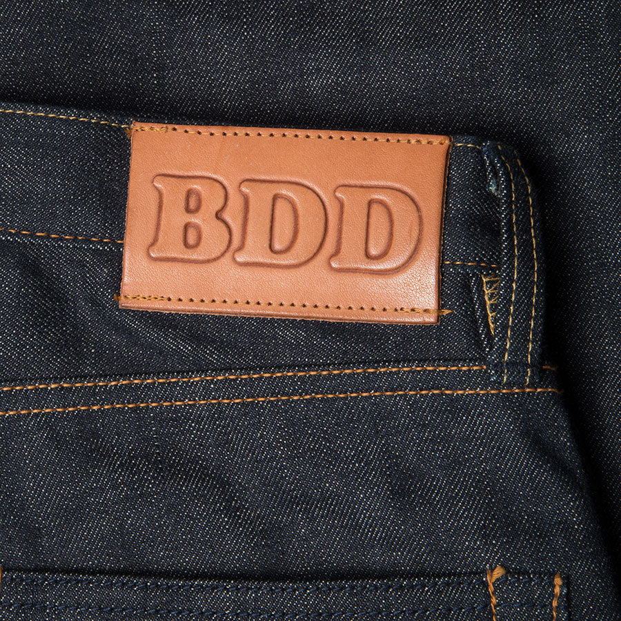 men's slim fit japanese selvedge denim jeans | indigo | made in japan | benzak BDD-006 green cast 15 oz. RHT | leather patch