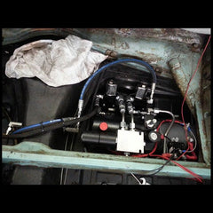 Hydraulic pump under karmann ghia rear seat